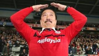 """Cardiff City owner Vincent Tan does the club celebration, the """"Ayatollah"""""""