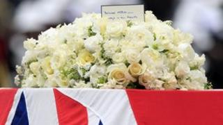 A note from Margaret Thatcher's children Mark and Carol rests on top of the flowers on her coffin