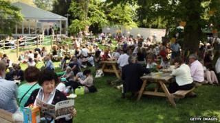 Crowds relax away from the displays at the Chelsea Flower Show