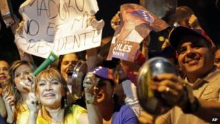 Supporters of opposition leader Nicolas Maduro use pots and pans to protest Nicolas Maduro's win in Sunday's presidential election