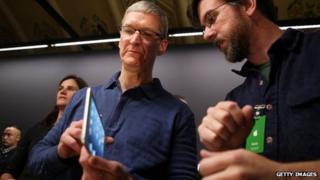 Tim Cook with iPad Mini