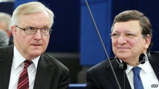 European Union Commissioner for Economic and Monetary Affairs Olli Rehn (L) and European Union Commission President Jose Manuel Barroso