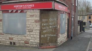 Boarded up corner shop on Portland Street