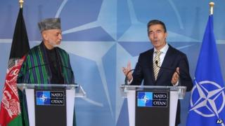 Nato Secretary General Anders Fogh Rasmussen, right, and Afghan President Hamid Karzai at a press conference at Nato headquarters in Brussels, 23 April 2013