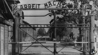 "Auschwitz concentration camp entrance with the sign ""Arbeit macht frei"" over it"