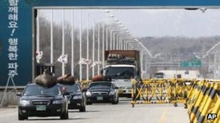 South Korean vehicles, loaded with products in North Korea's Kaesong, cross Unification Bridge after returning from Kaesong, near border village of Panmunjom in Paju, South Korea, 13 April 2013