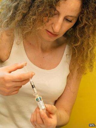 A woman taking a drug treatment for multiple sclerosis