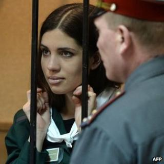 Nadezhda Tolokonnikova stands behind bars inside the courtroom in Zubova Polyana (26 April 2013)