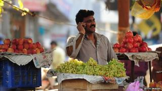 Man speaks on his mobile phone