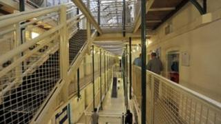 Prisoners in a cell block at Wormwood Scrubs, a Category B prison in London.