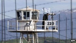 File image from from 8 March 2013 shows a UN peacekeeper using binoculars on an observation tower in the largely abandoned city of Quneitra, in the demilitarized United Nations Disengagement Observer Force (UNDOF) zone, in the Golan Heights
