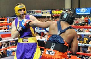 Tamerlan Tsarnaev (left) boxing in a match in the US, May 2009