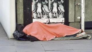 A homeless person sleeping