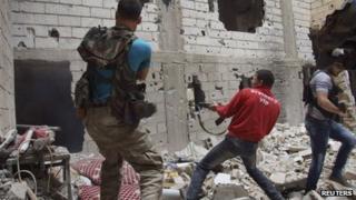 Syrian rebel fighters in Deir al-Zor, Syria, 13 May 2013