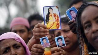 Relatives show pictures of garment workers who are missing, during a protest to demand capital punishment for those responsible for the collapse of the Rana Plaza building, in Savar, outside Dhaka April 29, 2013.