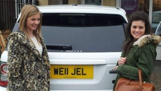 People posing with Range Rover