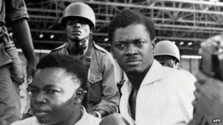 A picture taken in December 1960 shows soldiers guarding Patrice Lumumba