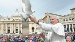 Pope Francis releases a white dove in St Peter's Square (15 May 2013)