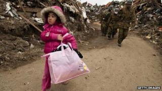 Families caught up in Japan's earthquake and nuclear damage