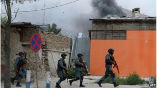 Afghan police run to the site of a gun battle, Kabul, 24 May 2013