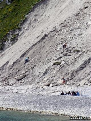 People climbing on the landslip rocks on Saturday
