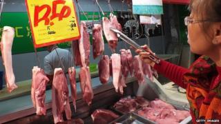 Woman buys Shuanghui supplied pork