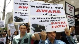 Human rights activists protest outside Laotian Embassy in Seoul, 31 May