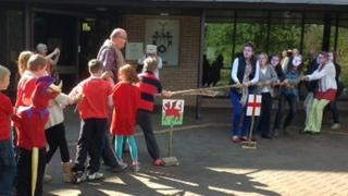 Friends of John Beddoes School staged a tug-of-war protest outside County Hall in Llandrindod Wells