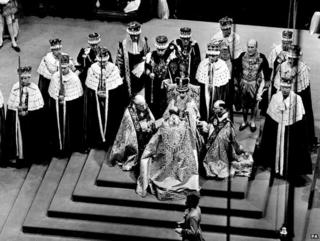 Coronation, with the archbishop kneeling before the Queen