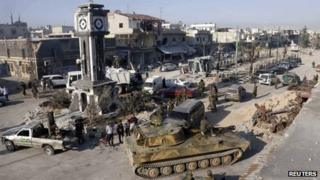 A general view shows soldiers loyal to the Syrian regime with their military tanks in Qusair