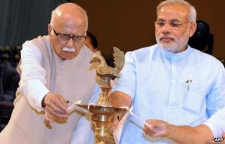 In this photograph taken on April 30, 2010, Chief Minister of the western Indian state of Gujarat Narendra Modi (R) looks on as senior Bharatiya Janata Party (BJP) leader L.K Advani lights a lamp during a ceremony in Ahmedabad. Vete