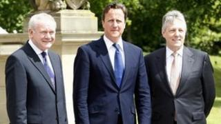 Prime Minister David Cameron with Martin McGuinness and Peter Robinson at Stormont Castle.