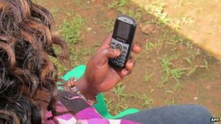 A woman using a mobile phone in Uganda - July 2012