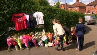 Young people leave floral tributes the the teenager stabbed to death