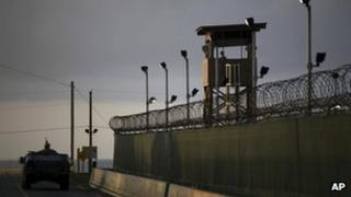 A US military vehicle patrols the perimeter of the prison at Guantanamo Bay (30 March 2010)