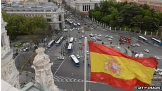 The Spanish flag flys at the Plaza de Cibeles in the Spanish capital Madrid