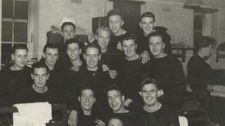 Phillip Mallorie (top row, far right) and Frank Walton (second from the right on row in front of Phillip)