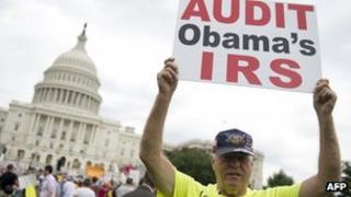 "Demonstrators with the Tea Party protest the Internal Revenue Service (IRS) targeting of the Tea Party and similar groups during a rally called ""Audit the IRS"" outside the US Capitol in Washington, DC 19 June 2013"