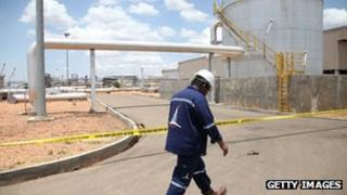 An oil worker walks in an oil production facility in Paloch in South Sudan's Upper Nile state
