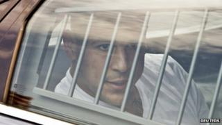 New England Patriots tight end Aaron Hernandez is led out of the North Attleborough police station after being arrested 26 June 2013