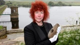 Joann Fletcher with the Neolithic axe
