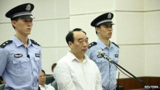 Lei Zhengfu attends his trial at a court in Chongqing municipality on 19 June 2013