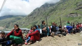 Stranded Indian pilgrims wait in line for their turn to be evacuated in an Indian Air Force helicopter at Badrinath on June 29, 2013