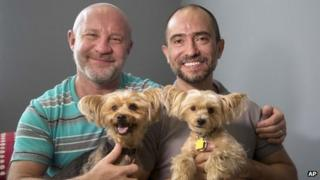 Julian Marsh, left, and Traian Popov and their Yorkshire Terriers at their home in Fort Lauderdale, Florida, on 1 July 2013
