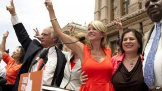 Wendy Davis (in red dress) outside the state Capitol in Austin, Texas 1 July 2013