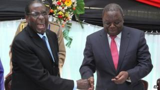 Robert Mugabe (on left) and Morgan Tsvangirai in Harare on 22 May 2013