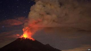 Ash spew from Mexico's Popocatepetl volcano, seen from San Mateo Ozolco, in the Mexican central state of Puebla, on 4 July