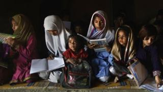 Makeshift school in a clay house on the outskirts of Islamabad, Pakistan