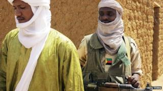 Fighters with the MNLA (National Movement for the Liberation of Azawad) stands guard as members of the group met with the Malian army, the UN mission in Mali and French army officers, in Kidal June 23, 2013