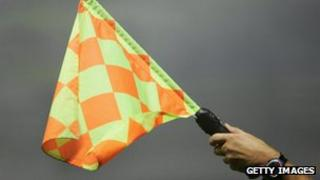 File photo of referee holding flag